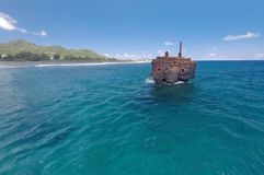 Shipwreck of the RMS Maitai in Avarua harbour Rarotonga Cook Isl. The 100 year old shipwreck of the RMS Maitai that was wrecked on the North Reef of Avarue Stock Images