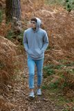 18 year old teenage boy walking in the woods. On an autumn day Stock Photography
