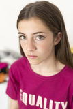15 year old teenager portrait. With serious face on a white background. It takes with natural light that enters through a window Royalty Free Stock Image