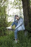 16 year old teenager sitting next to a tree Royalty Free Stock Photography