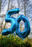 50 year old today balloon. Helium with woods in the background bokeh style Stock Photography