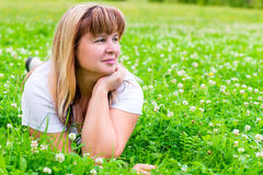 50-year-old woman on a green meadow Stock Photography