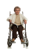 80 Year Old Woman Sit in Wheelchaire Reading Isolated Royalty Free Stock Images