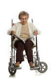 80 Year Old Woman Sit in Wheelchaire Reading Isolated Stock Photography