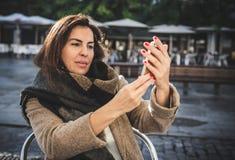 40 year old woman taking selfie Stock Photo