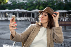 40 year old woman taking selfie stock photo