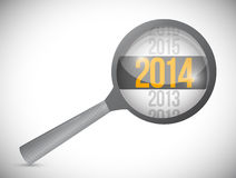 Year 2014 over a magnify glass. illustration. Design over white Royalty Free Stock Photography