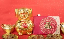 2019 is year of the pig,Golden piggy bank. 2019 is year of the pig,Golden piggy bank,calligraphy on pig translation: good bless for saving and wealth. Chinese royalty free stock photography