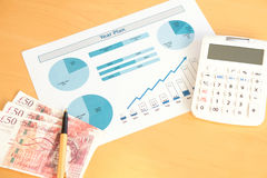 A Year plan with calculator and money. Year plan with calculator and money stock photography