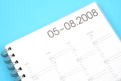 Year planner. Close-ups of year planner on blue background Royalty Free Stock Photo