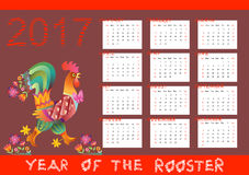 Year of the rooster - calendar with chinese symbol of 2017 year. Year of the rooster - bright calendar with chinese symbol of 2017 year.  Colorful rooster Royalty Free Stock Photo