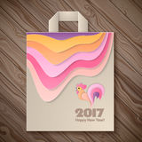 Year of rooster design for paper bag. Happy New Year 2017 and christmas template on the wooden background. Year of rooster design for paper bag. Vector Stock Photography
