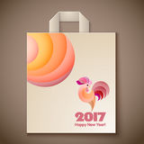 Year of rooster design for paper bag. Happy New Year 2017 and christmas template on the wooden background. Year of rooster design for paper bag. Vector Royalty Free Stock Photos