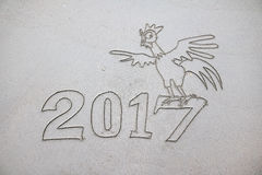 2017 Year of the Rooster , writing on the sand. Royalty Free Stock Images