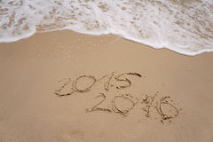 2015 and 2016 year on the sand beach Stock Photo