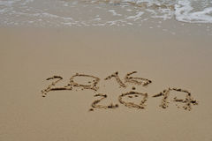 2016 and 2017 year on the sand beach Royalty Free Stock Photos