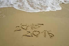 2015 and 2016 year on the sand beach Royalty Free Stock Photos