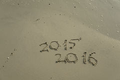 2015 and 2016 year on the sand beach Stock Images