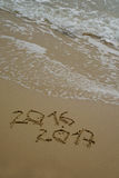 2016 and 2017 year on the sand beach Stock Photo