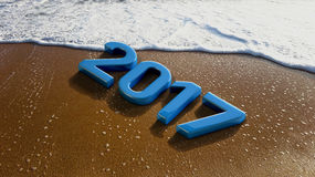 2017 Year on Sandy Beach with Sea Bubbles Royalty Free Stock Image
