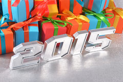 2015 year silver figures on the background of gifts Stock Photos