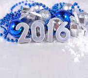 2016 year silver figures and silvery and blue Christmas decorati Royalty Free Stock Photos