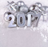 2017 year silver figures and silvery Christmas decorations Royalty Free Stock Images