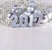 2017 year silver figures and silvery Christmas decorations Royalty Free Stock Photography