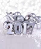 2017 year silver figures and silvery Christmas decorations Stock Image