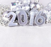 2016 year silver figures and silvery Сhristmas decorations Royalty Free Stock Photography
