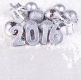 2016 year silver figures and silvery Сhristmas decorations Royalty Free Stock Images