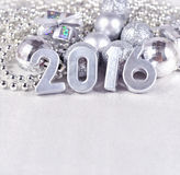 2016 year silver figures and silvery Сhristmas decorations Stock Photography