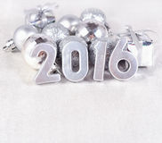 2016 year silver figures and silvery Сhristmas decorations Royalty Free Stock Photos