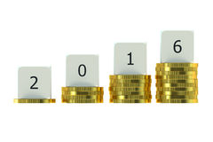 Year 2016 on Stacks of Gold Coins Stock Photos