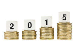 Year 2015 on Stacks of Gold Coins White Background. Business, banking, investment and finance concept. Stacks of gold coins showing growth and increase. Wishing Royalty Free Stock Photography