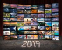 2019 year and technology concept as video wall. Video wall in TV production room as technology and 2019 concept with colorful screens Stock Photo
