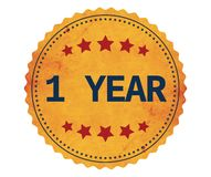 1-YEAR text, on vintage yellow sticker stamp. Royalty Free Stock Photography