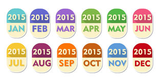 Year 2015 with twelve months labels. Year 2015 with twelve months, elliptic flat design labels, calendar concept elements Royalty Free Stock Images