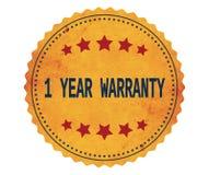 1-YEAR-WARRANTY文本,在葡萄酒黄色贴纸邮票 免版税库存照片
