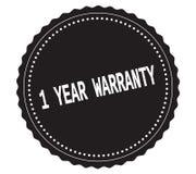 1-YEAR-WARRANTY文本,在黑贴纸邮票 免版税库存照片