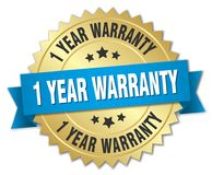 1 year warranty. Gold badge with blue ribbon Stock Photography