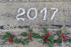 Year 2017 white tinsel on a old painted wooden background with Christmas toys Royalty Free Stock Photography