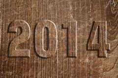 Year 2014 in wood. Image of year 2014 as a wood cutout glued on a wooden panel Stock Image