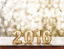 2016 year wood texture on marble table with gold sparkling bokeh Royalty Free Stock Photos