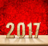 2017 year wood texture on plain wood table top with red sparklin Stock Photo