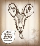 Year wooden goat. Happy New Year and Merry Christmas card. Hand drawn sketch portrait of sheep vector illustration