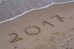 Year 2017 writen in the sand Royalty Free Stock Photo