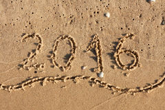 Year 2016 Written On Beach Sand Stock Photo