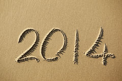 2014 year written on the beach sand Royalty Free Stock Photos