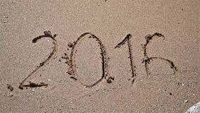 Year 2016 Written On Beach Sand stock video
